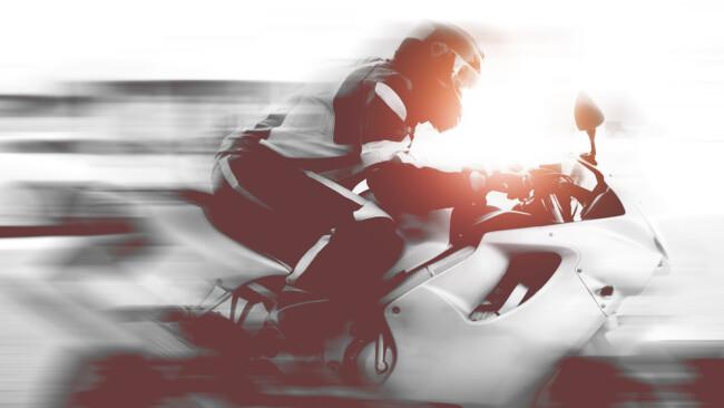 Raser Motorrad Biker Symbolbild